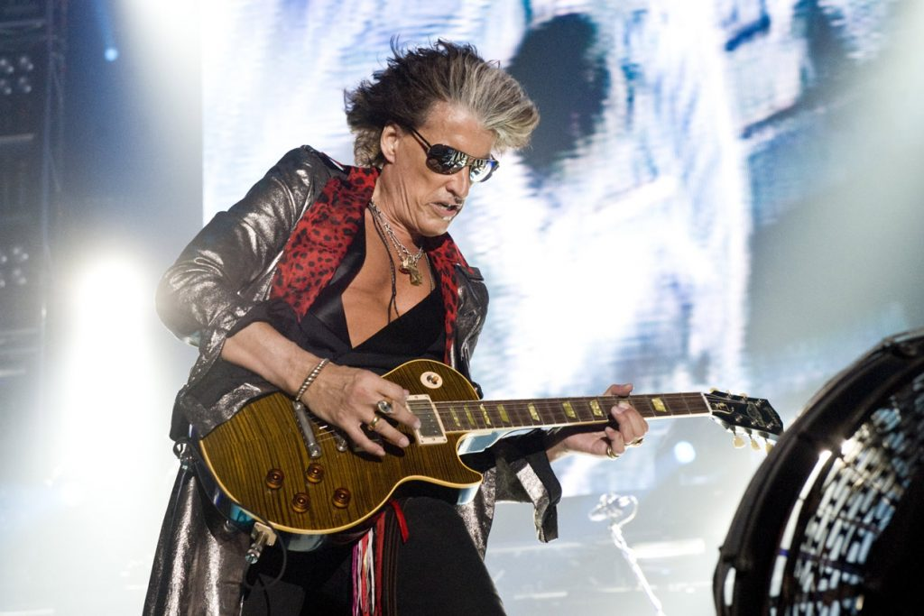 joe perry playing guitar